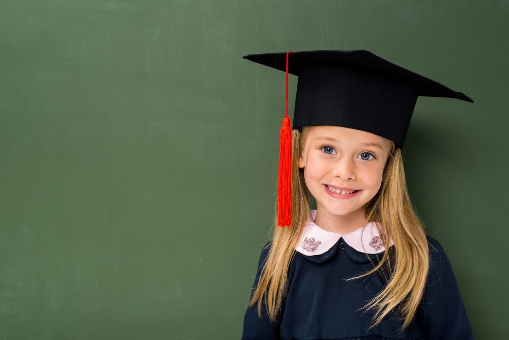 young girl in graduation cap