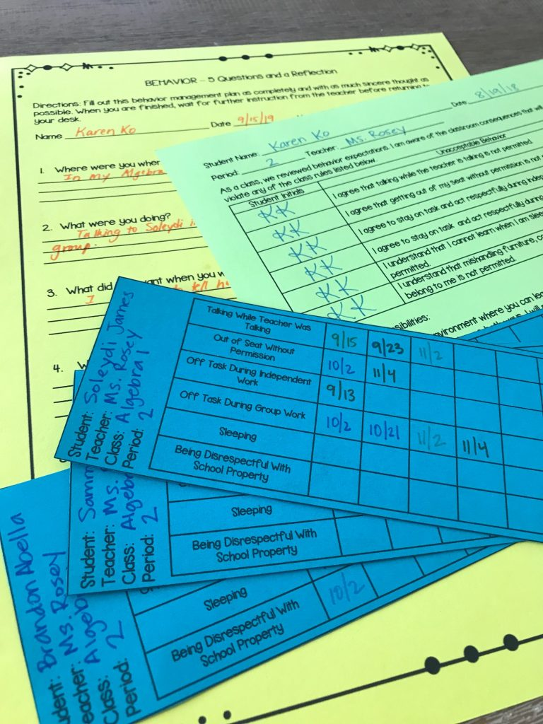 a close up of three classroom management forms