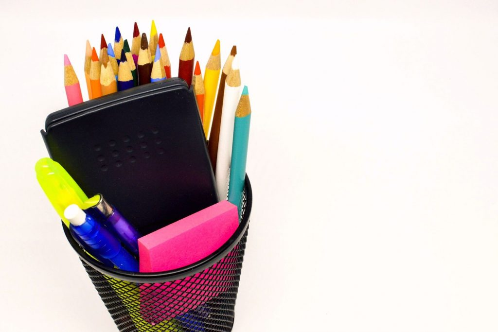 Cup full of school supplies - a key to classroom rules