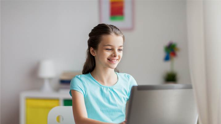 girl typing on computer