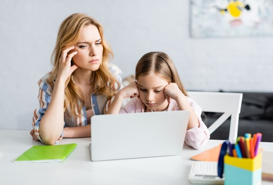 Frustrated mom and daughter on computer