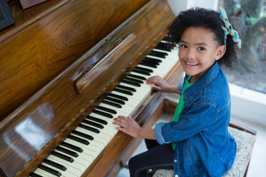 African American girl playing piano