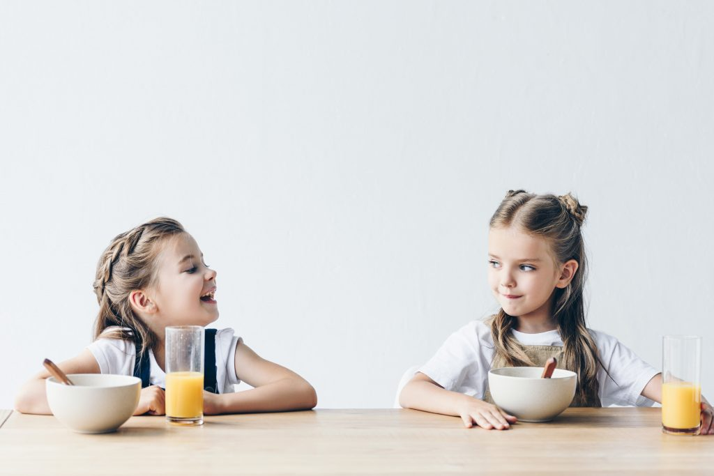 two girls eating breakfast