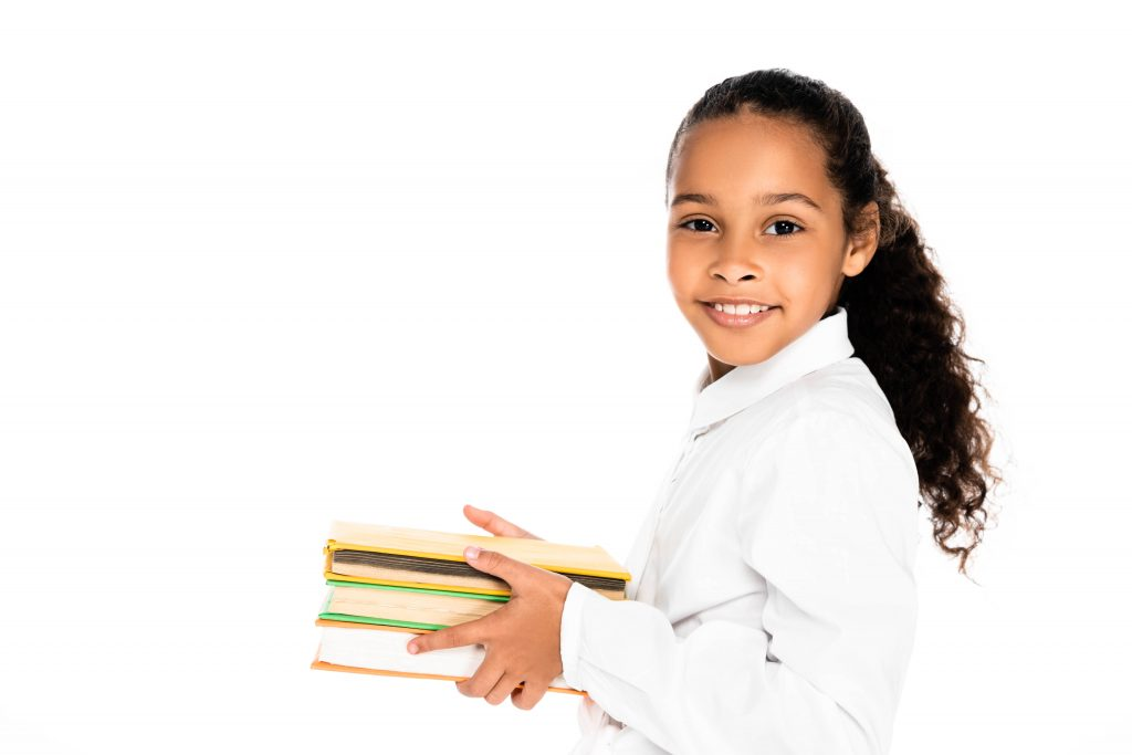 African American girl holding stack of textbooks