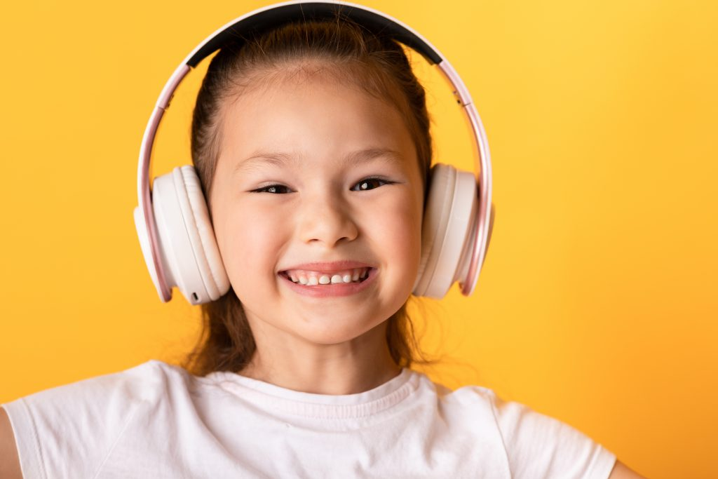 Smiling Asian girl wearing headphones